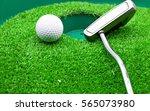 golf ball and putter were put...   Shutterstock . vector #565073980