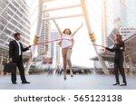 running businesswoman crossing... | Shutterstock . vector #565123138