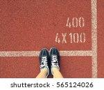 sport concept  violet sneakers... | Shutterstock . vector #565124026