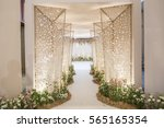 wedding backdrop with flower... | Shutterstock . vector #565165354