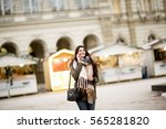 happy fashion woman using a... | Shutterstock . vector #565281820