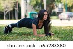 young woman doing stretching... | Shutterstock . vector #565283380