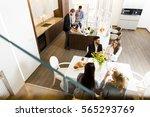 friends having dinner at home... | Shutterstock . vector #565293769
