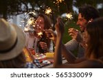 friends with sparklers eating...   Shutterstock . vector #565330099
