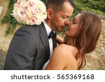 groom and bride outdoors on... | Shutterstock . vector #565369168