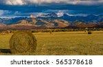 a large hay bale in a field in... | Shutterstock . vector #565378618