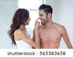 wife applying cream on... | Shutterstock . vector #565383658