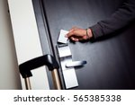 young indian man unlocking his... | Shutterstock . vector #565385338