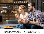 smiling couple drinking tea... | Shutterstock . vector #565393618