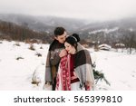 wedding in the snow | Shutterstock . vector #565399810