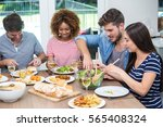 happy young friends having meal ... | Shutterstock . vector #565408324