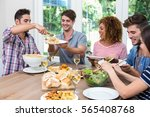 happy friends having meal at... | Shutterstock . vector #565408768