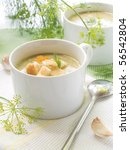 A cup of creamy vegetable soup - stock photo