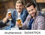 happy male friends drinking... | Shutterstock . vector #565447924