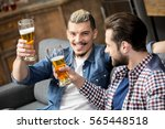 happy male friends drinking... | Shutterstock . vector #565448518