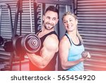 couple posing with dumbbells at ... | Shutterstock . vector #565454920