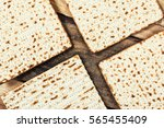 jewish matza on passover | Shutterstock . vector #565455409