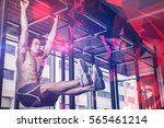 shirtless man doing pull up at... | Shutterstock . vector #565461214
