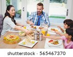 family having food while... | Shutterstock . vector #565467370
