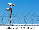 barbed wire fence with security ... | Shutterstock . vector #565505638