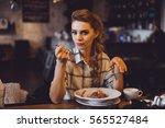 beautiful girl blonde hair and... | Shutterstock . vector #565527484