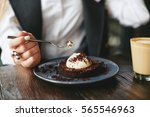 girl eating chocolate dessert... | Shutterstock . vector #565546963