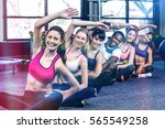 fit smiling group doing... | Shutterstock . vector #565549258
