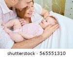 baby with his parents happy... | Shutterstock . vector #565551310