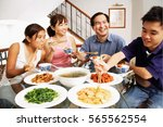 family eating at home | Shutterstock . vector #565562554