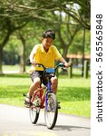 boy on bicycle | Shutterstock . vector #565565848