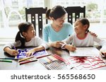 mother with two girls | Shutterstock . vector #565568650