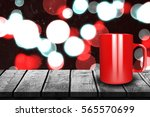 close up of red mug against... | Shutterstock . vector #565570699