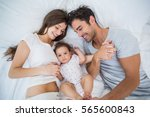 high angle view of family lying ... | Shutterstock . vector #565600843