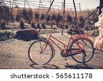 vintage bicycle on vintage... | Shutterstock . vector #565611178