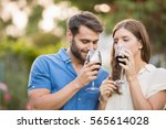 couple drinking wine while... | Shutterstock . vector #565614028