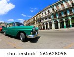 old car and building in cuba... | Shutterstock . vector #565628098