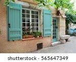 window with shutters and door... | Shutterstock . vector #565647349