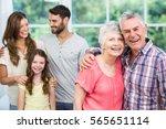 portrait of grandparents with... | Shutterstock . vector #565651114