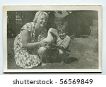 Vintage portrait of mother and daughter with a goose (fifties) - stock photo