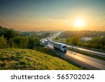 white trucks driving on the... | Shutterstock . vector #565702024