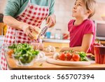 mother and daughter preparing... | Shutterstock . vector #565707394