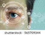 young man's eye and technology... | Shutterstock . vector #565709344
