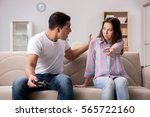 young family suffering from... | Shutterstock . vector #565722160