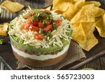 homemade mexican 7 layer dip... | Shutterstock . vector #565723003
