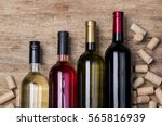 wine bottle and corks... | Shutterstock . vector #565816939