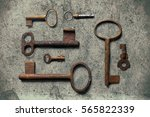 old key on the old textured... | Shutterstock . vector #565822339