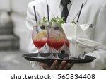 waiter serving drinks   cocktail   Shutterstock . vector #565834408