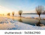 winter landscape of a polder... | Shutterstock . vector #565862980