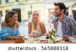 group of young people laughing... | Shutterstock . vector #565888318