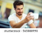 young man making selfie with... | Shutterstock . vector #565888990